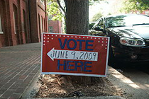 Picture of a sign directing people where to vote