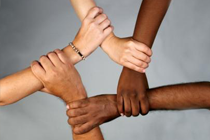 Picture of a diverse set of individuals holding hands